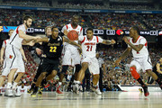 Carl Hall #22 of the Wichita State Shockers reaches for the ball against (from L) Luke Hancock #11, Gorgui Dieng #10, Peyton Siva #3 and Russ Smith #2 of the Louisville Cardinals during the 2013 NCAA Men's Final Four Semifinal at the Georgia Dome on April 6, 2013 in Atlanta, Georgia.