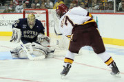 Mike Johnson #32 of the Notre Dame Fighting Irish stops a shot by Kyle Schmidt #7 of the Minnesota Duluth Bulldogs during semifinals of the 2011 NCAA Men's Frozen Four on April 7, 2011 at the Xcel Energy Center in St. Paul, Minnesota.