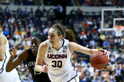 Breanna Stewart #30 of the Connecticut Huskies drives with the ball against Chiney Ogwumike #13 of the Stanford Cardinal in the second half during the NCAA Women's Final Four semifinal at Bridgestone Arena on April 6, 2014 in Nashville, Tennessee.