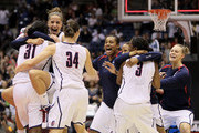 (L-R) Tina Charles #31, Caroline Doty #5 and Kelly Faris #34 of the Connecticut Huskies celebrate a 53-47 win against the Stanford Cardinal during the NCAA Women's Final Four Championship game at the Alamodome on April 6, 2010 in San Antonio, Texas.