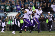 Patrick Robinson #21 of the Philadelphia Eagles returns an interception for a touchdown during the first quarter past Riley Reiff #71 and Rashod Hill #69 of the Minnesota Vikings in the NFC Championship game at Lincoln Financial Field on January 21, 2018 in Philadelphia, Pennsylvania.
