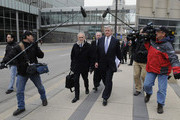 NFL lawyer Bob Batterman (L), owner Jerry Jones of the Dallas Cowboys and owner Jerry Richardson of the Carolina Panthers leave court ordered mediation at the U.S. Courthouse on April 19, 2011 in Minneapolis, Minnesota. Mediation was order after a hearing on an antitrust lawsuit filed by NFL players against the NFL owners after labor talks between the two broke down last month.