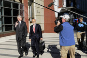 The NFL's Carolina Panthers owner Jerry Richardson (L) and NFL lawyer Bob Batterman leave court-ordered mediation at the U.S. Courthouse on May 16, 2011 in Minneapolis, Minnesota. Mediation was ordered after a hearing on an antitrust lawsuit filed by NFL players against the NFL owners that followed a breakdown of labor talks between the two in March.