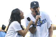 Actors Mila Kunis and Ashton Kutcher announce the Los Angeles Dodgers starting lineup prior to game four of the National League Championship Series against the Chicago Cubs at Dodger Stadium on October 19, 2016 in Los Angeles, California.