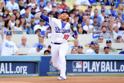 Justin Turner #10 of the Los Angeles Dodgers throws the ball to first to throw out Kris Bryant #17 of the Chicago Cubs in the first inning in game four of the National League Championship Series at Dodger Stadium on October 19, 2016 in Los Angeles, California.