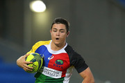 Michael Adams of the Rays runs the ball during the round four National Rugby Championship match between Queensland Country and the North Harbour Rays at Cbus Super Stadium on September 13, 2014 in Gold Coast, Australia.