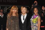 David Guetta, wife Cathy Guetta (L) and Kelly Rowland attend the NRJ Music Awards 2010 at Palais des Festivals on January 23, 2010 in Cannes, France.