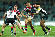 Sonny Bill Williams of the Roosters is tackled by Jamal Idris of the Panthers during the NRL 1st Qualifying Final match between the Sydney Roosters and the Penrith Panthers at Allianz Stadium on September 13, 2014 in Sydney, Australia.