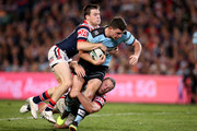 Chad Townsend of the Sharks is tackled during the NRL Qualifying Final match between the Sydney Roosters and the Cronulla Sharks at Allianz Stadium on September 8, 2018 in Sydney, Australia.