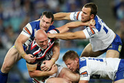 Craig Fitzgibbon of the Roosters is tackled by Michael Hodgson, Gary Warburton and David Stagg of the Bulldogs during the round 24 NRL match between the Bulldogs and the Sydney Roosters at ANZ Stadium on August 24, 2009 in Sydney, Australia.