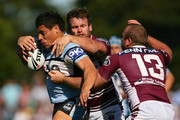 Anthony Tupou of the Sharks is tackled by Josh Perry (C) and Glenn Stewart (R) of the Sea Eagles during the round 25 NRL match between the Manly-Warringah Sea Eagles and the Cronulla Sharks at Brookvale Oval on August 30, 2009 in Sydney, Australia.