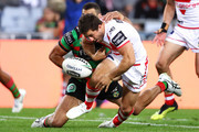 Greg Inglis of the Rabbitohs strips the ball off Ben Hunt of the Dragons  during the NRL Semi Final match between the South Sydney Rabbitohs and the St George Illawarra Dragons at ANZ Stadium on September 15, 2018 in Sydney, Australia.