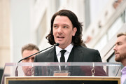 Singer JC Chasez speaks onstage during the ceremony honoring NSYNC with a star on the Hollywood Walk of Fame on April 30, 2018 in Hollywood, California.