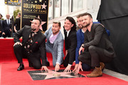 Singers Chris Kirkpatrick, Lance Bass, JC Chasez, Joey Fatone and Justin Timberlake of NSYNC are honored with a star on the Hollywood Walk of Fame on April 30, 2018 in Hollywood, California.