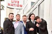 Chris Kirkpatrick, Lance Bass, Joey Fatone, JC Chasez and Justin Timberlake of NSYNC are honored with a star on the Hollywood Walk of Fame on April 30, 2018 in Hollywood, California.