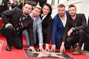 Chris Kirkpatrick, Lance Bass, JC Chasez, Joey Fatone and Justin Timberlake of NSYNC are honored with a star on the Hollywood Walk of Fame on April 30, 2018 in Hollywood, California.