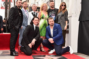 Chris Kirkpatrick, Joey Fatone, Justin Timberlake, JC Chasez and Lance Bass of NSYNC pose with family during the ceremony honoring NSYNC with a star on the Hollywood Walk of Fame on April 30, 2018 in Hollywood, California.