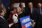 Sen. Kirsten Gillibrand (D-NY) (C) embraces FealGood Foundation co-founder John Feal during a news conference with (L-R) Rep. Jerrold Nadler (D-NY), Rep. Carolyn Maloney (D-NY), Sen. Chuck Schumer (D-NY) and Sen. Robert Menendez (D-NJ) after the Zadroga 9/11 health and compensation programs were included in the omnibus spending bill that passed Congress at the U.S. Capitol December 18, 2015 in Washington, DC. With a public awareness campaign lead by former Daily Show host Jon Stewart, the Zadroga legislation will provide money for healthcare for first responders and others suffering from diseases from the 9/11 attacks and for the families of those who have died.