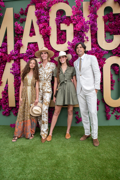 Celebrities Attend 2020 Magic Millions Raceday [green,social group,pink,formal wear,fun,event,fashion,ceremony,design,marriage,celebrities,josefina becco,nacho figueras,aurora figueras,delfina blaquier,l-r,gold coast turf club,australia,magic millions raceday,moet marquee magic millions raceday,aurora figueras,delfina blaquier,nacho figueras,photograph,getty images,photography,image,stock photography,livingly media]