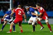 PJ Van Lill of Namibia is tackled by Giorgi Nemsadze of Georgia during the 2015 Rugby World Cup Pool C match between Namibia and Georgia at Sandy Park on October 7, 2015 in Exeter, United Kingdom.