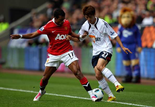 Nani Chung Yong Lee of Bolton Wanderers competes with Nani of Manchester United during the Barclays Premier League match between Bolton Wanderers and Manchester United at the Reebok Stadium on September 26, 2010 in Bolton, England.