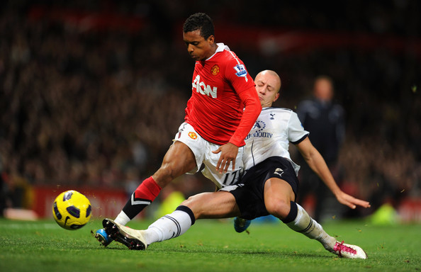Nani Nani of Manchester United in action with Alan Hutton of Tottenham during the Barclays Premier League match between Manchester United and Tottenham Hotspur at Old Trafford on October 30, 2010 in Manchester, England.