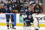 Dustin Byfuglien #33, Connor Hellebuyck #37 and Paul Stastny #25 of the Winnipeg Jets warms up prior to Game Six of the Western Conference Second Round during the 2018 NHL Stanley Cup Playoffs against the Nashville Predators on May 7, 2018 at Bell MTS Place in Winnipeg, Manitoba, Canada. (Photo by Jason Halstead /Getty Images) *** Local Caption *** Dustin Byfuglien; Connor Hellebuyck; Paul Stastny