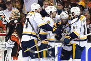 Mattias Ekholm #14, Roman Josi #59,=Pontus Aberg #46 and Colton Sissons #10 of the Nashville Predators celebrate Aberg's goal as Jonathan Bernier #1 of the Anaheim Ducks takes a drink of water in the third period of Game Five of the Western Conference Final during the 2017 Stanley Cup Playoffs at Honda Center on May 20, 2017 in Anaheim, California.