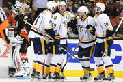 Mattias Ekholm #14, Roman Josi #59, Filip Forsberg #9, Pontus Aberg #46 and Colton Sissons #10 of the Nashville Predators celebrate Aberg's goal as Jonathan Bernier #1 of the Anaheim Ducks takes a drink of water in the third period of Game Five of the Western Conference Final during the 2017 Stanley Cup Playoffs at Honda Center on May 20, 2017 in Anaheim, California.