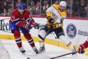Mattias Ekholm #14 of the Nashville Predators plays the puck past Max Pacioretty #67 of the Montreal Canadiens during the NHL game at the Bell Centre on February 10, 2018 in Montreal, Quebec, Canada.