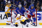Ryan Johansen #92 of the Nashville Predators is tripped up by Marc Staal #18 of the New York Rangers during the second period at Madison Square Garden on October 04, 2018 in New York City.