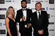 Winner of The Friends Life t20 Player of the Year Award Nadeem Malik (C) together with Karen Burrell and Dominic Cork pose for photographs during the NatWest PCA Awards Dinner 2011 at The Roundhouse on September 22, 2011 in London, England.