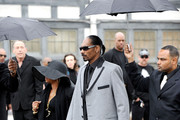 Rapper Snoop Dog and wife Shante Broadus arrive at Nate Dogg aka Nathaniel Dwayne Hale Funeral Service on March 26, 2011 in Long Beach, California.