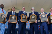 (L-R) Inductees Vladimir Guerrero, Trevor Hoffman, Chipper Jones, Jack Morris, Alan Trammell and Jim Thome pose for a photograph with the plaques at Clark Sports Center during the Baseball Hall of Fame induction ceremony on July 29, 2018 in Cooperstown, New York.