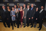 """(L-R) Gary Knell, Mae C. Jemison, Nicole Stott, Chris Hadfield, Jane Root, Leland D. Melvin, Peggy Whitson, Jeffrey A. Hoffman, Jerry M. Linenger, Michael J. Massimino, Courteney Monroe and Tim Pastore attend National Geographic's world premiere screening of """"One Strange Rock"""" on Wednesday, March 14, 2018 in New York City.  Hosted by Will Smith, """"One Strange Rock"""" is a mind-bending, full-sensory journey across 45 countries, six continents and outer space, exploring the wonder and fragility of our curiously calibrated Earth."""