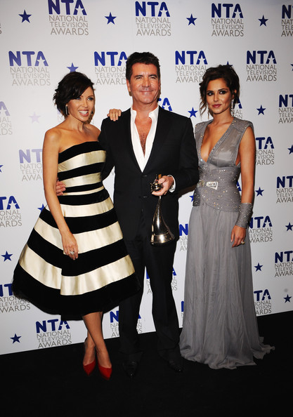 (L-R) X Factor judges Danni Minogue, Simon Cowell and Cheryl Cole appear with their award for Most Popular Talent Show at the National Television Awards held at O2 Arena on January 20, 2010 in London, England.