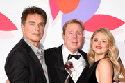 John Barrowman, Harry Redknapp and Emily Atack with The Bruce Forsyth Entertainment Award for I'm A Celebrity… Get Me Out Of Here!  during the National Television Awards held at The O2 Arena on January 22, 2019 in London, England.