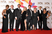 (L-R) Fleur East, Harry Redknapp, Nick Knowles, Emily Atack, John Barrowman, Anne Hegerty, James McVey and Scarlett Moffatt pose with The Bruce Forsyth Entertainment Award for I'm A Celebrity… Get Me Out Of Here!  during the National Television Awards held at The O2 Arena on January 22, 2019 in London, England.