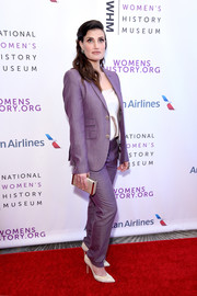 Idina Menzel opted for a lilac pantsuit when she attended the Women Making History Awards.