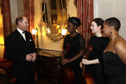 Prince Edward, Earl of Wessex (L) with National Youth Theatre performers during the National Youth Theatre Baroque And Roll Fundraising Gala 2020 at Spencer House on February 11, 2020 in London, England.