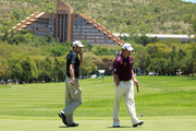 Englishmen Ross Fisher and Lee Westwood cross paths on the first green during the third round of the 2010 Nedbank Golf Challenge at the Gary Player Country Club Course  on December 4, 2010 in Sun City, South Africa.