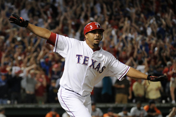 Nelson Cruz #17 of the Texas Rangers runs the bases after hitting a walk off grand slam home run in the bottom of the 11th inning to win Game Two of the American League Championship Series 7-3 against the Detroit Tigers at Rangers Ballpark in Arlington on October 10, 2011 in Arlington, Texas.