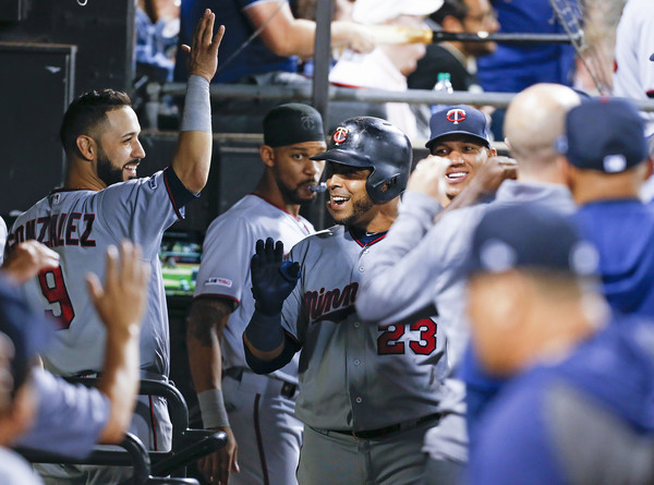 Minnesota Twins vs Chicago White Sox [fan,product,team sport,baseball player,sports,baseball,player,ball game,baseball uniform,team,nelson cruz,guaranteed rate field,chicago,illinois,minnesota twins,chicago white sox,home run,game]