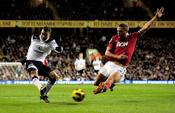 Nemanja Vidic Aaron Lennon of Spurs attempts to cross the ball as Nemanja Vidic of Manchester United closes in during the Barclays Premier League match between Tottenham Hotspur and Manchester United at White Hart Lane on January 16, 2011 in London, England.