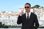 "Danish director Nicolas Winding Refn poses on May 20, 2016 during a photocall for the film ""The Neon Demon"" at the 69th Cannes Film Festival in Cannes, southern France.  / AFP / ANNE-CHRISTINE POUJOULAT"