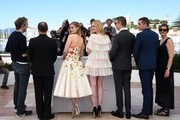 "Australian actress Bella Heathcote (3rdL) and US actress Elle Fanning (C) pose on May 20, 2016 with German editor Matthew Newman (L), US composer Cliff Martinez (2ndL), Danish director Nicolas Winding Refn (3rdR), US actor Karl Glusman (2ndR) and Danish producer Lene Borglum during a photocall for the film ""The Neon Demon"" at the 69th Cannes Film Festival in Cannes, southern France.  / AFP / ANNE-CHRISTINE POUJOULAT"