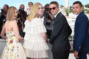 "(FromL) Australian actress Bella Heathcote, US actress Elle Fanning, Danish director Nicolas Winding Refn and US actor Karl Glusman pose on May 20, 2016 during a photocall for the film ""The Neon Demon"" at the 69th Cannes Film Festival in Cannes, southern France.  / AFP / ANNE-CHRISTINE POUJOULAT"