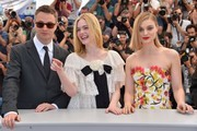 "(FromL) Danish director Nicolas Winding Refn, US actress Elle Fanning and Australian actress Bella Heathcote pose on May 20, 2016 during a photocall for the film ""The Neon Demon"" at the 69th Cannes Film Festival in Cannes, southern France.  / AFP / LOIC VENANCE"