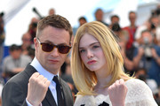 "Danish director Nicolas Winding Refn (L) and US actress Elle Fanning pose on May 20, 2016 during a photocall for the film ""The Neon Demon"" at the 69th Cannes Film Festival in Cannes, southern France.  / AFP / LOIC VENANCE"