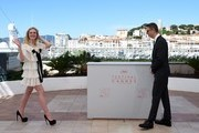 "US actress Elle Fanning (L) and Danish director Nicolas Winding Refn pose on May 20, 2016 during a photocall for the film ""The Neon Demon"" at the 69th Cannes Film Festival in Cannes, southern France.  / AFP / ANNE-CHRISTINE POUJOULAT"
